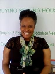 Maria Maqdika, estate agent